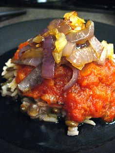 An easy variation of Kushari. Lentils and rice topped with a spicy tomato sauce and caramelized onions. Photo by Jeni Hill