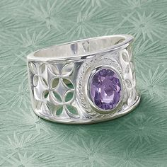 Silver Priestess. Sparkling like the jeweled center of a breastplate, a genuine, faceted amethyst adorns the openwork, sterling silver setting of this Renaissance-inspired ring.