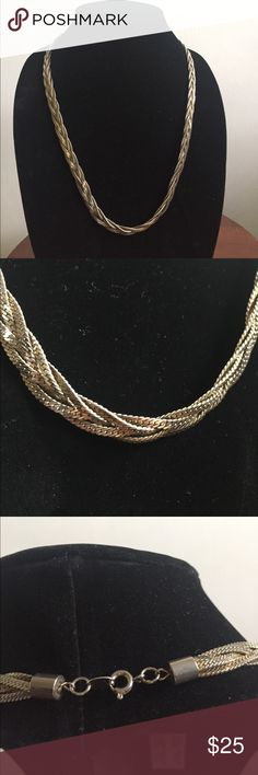 Silver Braided necklace Very pretty piece. No markings except Korea. I believe it may be silver plate but unsure. 25 inches long. Great statement piece! Jewelry Necklaces