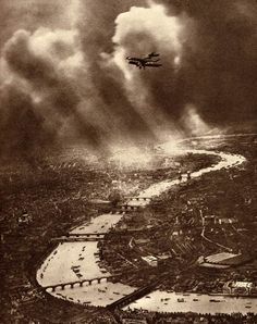 "London by Alfred Buckham, pioneer of aerial photography. Despite nine crashes he said, ""If one's right leg is tied to the seat with a scarf or a piece of rope, it is possible to work in perfect security."""