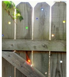 glass gems in wooden fence