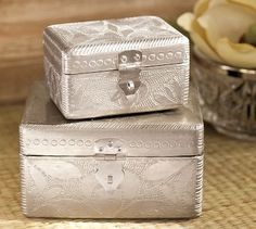 Different silver boxes to hide Christmas lovelies!