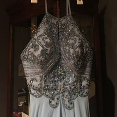 Halter Prom dress Never worn, only thing done to it was got pads sewn in but can be removed. Periwinkle color! Morrell Maxie Dresses Prom