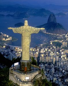 Aerial view of Christ, symbol of Rio de Janeiro, standing on top of Corcovado Hill, overlooking Guanabara Bay       Brazil Travel Guide