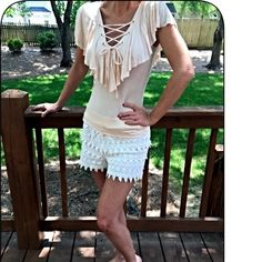 Cream ruffle lace up top! Beautiful fit with a hint of stretch for a flattering look- ruffled all around top with a lace up front- this is a must have piece! Tops