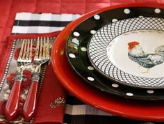 The textures and patterns on this table setting are pivoting.  The elegant red flatware, black & white polka dot dishes, and rooster salad plate all combine to become eye candy.