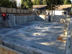 October 22nd 2012 - While the crew finishes up the back filling around the sides of the foundation, the basement floor is now in place.