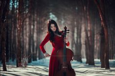 Girl playing the cello in forest