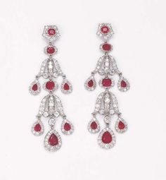 A PAIR OF ATTRACTIVE BELLE EPOQUE RUBY AND DIAMOND PENDANT EARRINGS. Each designed as three ruby and diamond pear-shaped cluster drops to an openwork frame suspended from a similar motif, circa 1905, 6.5 cm. long