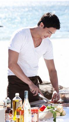 Daniel Henney. He cooks! On the beach! ;)