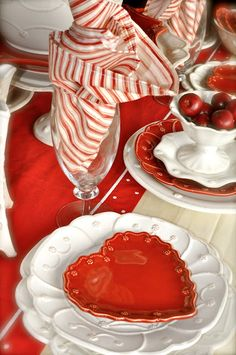 We love mixing the Juliska heart plates with the white Jardins or Berry and Thread pattern.  Mix in Vietri linens, fun stems, red berries and your table will be set!  This table is perfect for Valentines!