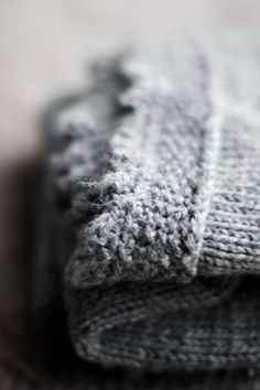 Grey picot...Making the background natural blurry in order to focus on the textures and shapes made in the knitting.