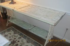 A vintage table made from old doors and sewing machine legs.