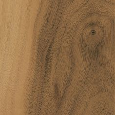 Natural is a clear cabinet finish allowing the beauty of the Walnut woodgrain to show through.