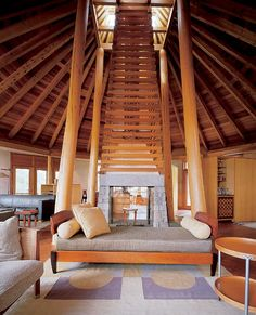 Beach house turret:  love the crazy fireplace and chimney; pillars; great day bed