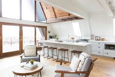 Bright and realistic in Dwell: An A-Frame Cabin Boasts Serious Scandinavian Vibes - Photo 10 of 14 - Fully glazed doors open to one of the large decks. A Frame House Plans, A Frame Cabin, A Frame Floor Plans, Airy Bedroom, Bathroom Design Layout, Light Hardwood Floors, Cabin Interiors, Cuisines Design, Kitchen Designs
