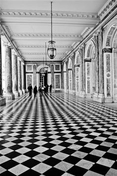 Walking in Black and White-Versailles, France by Rebecca Plotnick