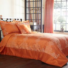 Lucerne Orange Bedspread | Our exclusive Victoria range represents the ultimate in femininity and indulgence! The face of the duvet cover and pillowcase is crafted in a silky soft sateen fabric that is subtly decorated with antique coloured lace. #Kaleidoscope #Bedroom #Bedding #Bed #Style #Home www.kaleidoscope.co.uk