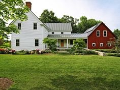Pretty much what our house will look like. White upright and wing with attached red gable barn garage.