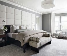 With just about every surface in this bedroom padded with down, carpet, fabric, or cushions, it might make a person collapse in a happy heap wherever they please—there's not a bad seat in the house! And we're sure this homeowner didn't skip on a comfy mattress topper. With white, black, and a variety of grays smoothed across floors, walls, ceilings, sheets, and furniture, the (non)color scheme ensures a serene spot for recharging.
