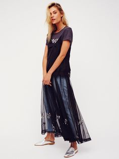 Moonlight Mesh Wrap Slip   Sheer mesh maxi slip featuring sparkling sequin embellishments near the hem. A wrap tie at the waist creates a cute and comfortable fit.