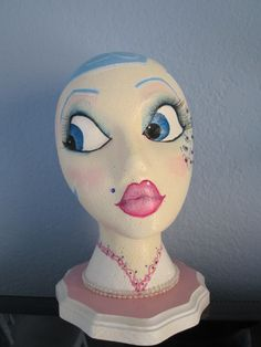 Hand Painted Mannequin Head for Wig/Hat Display or Decoration. $45.00, via Etsy.