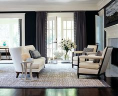 love the area rug pattern with the detailed drapery. Dark and light