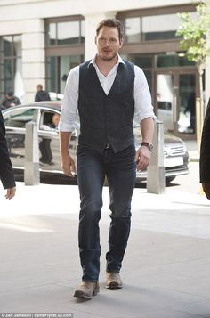 What a gent: The Hollywood star looked smart in jeans and a grey waistcoat as he arrived at the studios