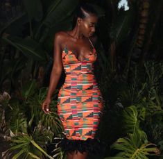 Enjoy this African Kente Coutore spagetti strap dress with feathers. African Prom Dresses, Latest African Fashion Dresses, African Print Fashion, Africa Fashion, African Prints, African Attire, African Wear, African Women, African Dress