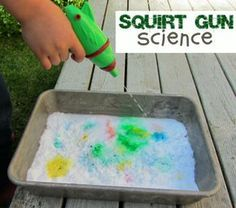 Squirt Gun Science easy science for kids. Put drops of food coloring under a layer of baking soda. Fill a squirt gun with vinegar and shoot! Watch fizzie colored bubbles! FUN!