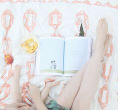 Lying on a Blanket reading a book in a strawberry field