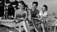 Glroiously handsome & happy: Louis Jourdan in 1952 with his wife Berthe and Anne Vernon