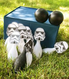 Tape free printables onto a dollar store bowling set for a Stormtrooper face-off.