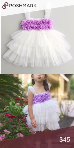 The Purple Flower Viola Dress 🌸 White with Purple flowers Tutu Dress  Perfect dress for a wedding. Can be formal or casual  Tulle, Lace, and cotton  Size: 4  Never been worn   From a clean, smoke free home Modernechild Dresses