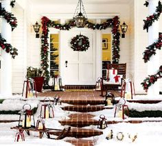 Nice garland wrapped around the columns. Also loving the porch lights on either side of door.