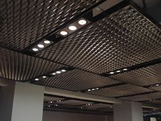 ceiling of the DDC Minotti building uses large panels of very three-dimensional expanded metal mesh