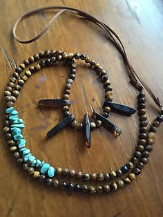 Suede leather attached to tigers eye and turquoise beads with edgy black/brown accents. Double the necklace to make a choker with the  $48