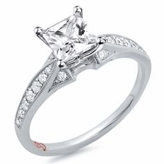 Designer Engagement Rings from DemarcoJewelry.com  Available in White Gold 18KT and Platinum.0.18 RD  Capture her grace and endless beauty with this confident yet elegant design.  We have also incorporated a unique pink diamond with every single one of  our rings, symbolizing that hidden, unspoken emotion and feeling one  carries in their heart about their significant other.    This is not just another ring, this is a heirloom piece of jewelry.