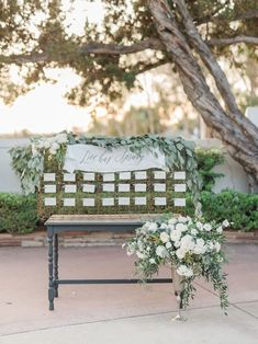 Greenery and vintage-style seating chart outdoor  | Muckenthaler Mansion Fullerton, CA