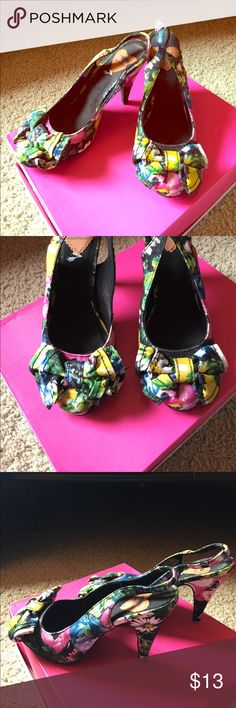 Cute Floral Pumps These cute yellow, blue, pink, green, white and black pumps are so cute! These even have a bow on the front. And these are also so comfy! Great condition! Rocket Dog Shoes Heels