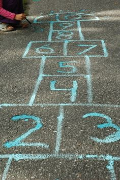 Hopscotch...a stick of chalk, and you could play anywhere... haha tried to do this the other day.. not a good look!