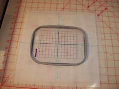 Centering fabric in embroidery hoop