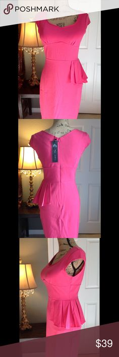 NWT Pink Peplum Dress M NWT.  Gorgeous sexy and playful peplum dress.  Pink in color.  Stretchy fabric.  Zipper in the back.  Fitted and hugs your body.  From a smoke free home. Dresses
