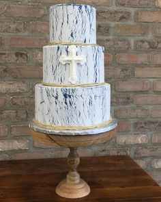 Order Communion Cake from A Little Cake and make your special occasion a memorable event with a custom designed first communion cake. This lovely 3 tiered buttercream first holy communion cake features #rustic and #crackle #texture and rustic wooden cake stand add the perfect woodland finishing touch. #communion #communioncake #cake #parkridgenj #alittlecake #yummy #rustic #crackle #texture