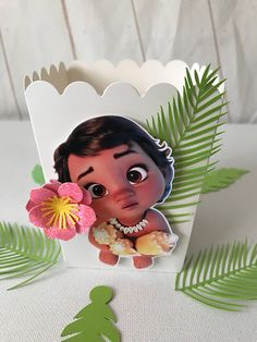 Baby Moana pop corn boxes with fancy edging. The listing is for 6 Pop corn boxes. Each topper measures approximately Width:3 (top) the box is open on top and is great for just the right size servings. Tall 4 Boxes are shipped flat but fully decorated. Just pop the bottoms into place.