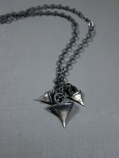 BLOODMILK, CAST ROSE THORN NECKLACE: sterling silver; handmade and oxidised