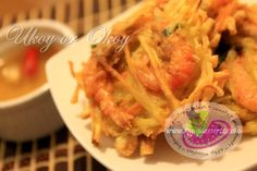 """Ukoy or Okoy Recipe. Ukoy is a native Filipino street food snack. This recipe has a wide range of vegetable combinations and versions to choose from. The original Ukoy recipe is made from """"kalabasa"""" or squash, bean sprouts, scallions with fresh baby shrimps and cooked deep fried. In this recipe, I used """"camote"""" or sweet potato, carrots, scallions, and baby shrimp."""