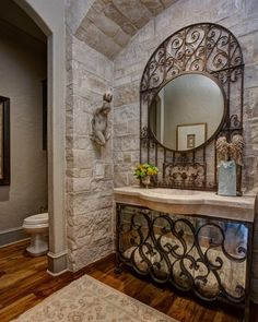 European Inspired Design... love the antique mirror behind the iron (hides the plumbing)