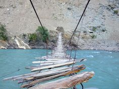 Suspension bridges are suspended from cables. The earliest suspension bridges were made of ropes or vines covered with pieces of bamboo. In this picture the suspension bridge, which is now only for human use, is in Astore Valley. This type of bridge is found in the Gilgit-Baltistan area of Pakistan.