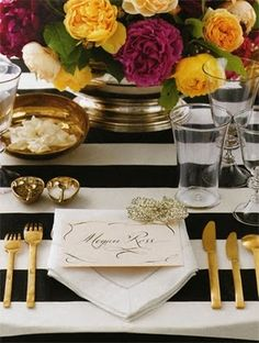 I love the stripes and the gold flatware, not to mention the flowers and on and on...